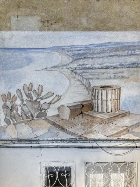 La costa, il mare, un fico d'India e un richiamo al passato più antico della regione. In questo murales c'è tutta la costa calabrese
